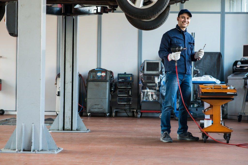 man at car repair shop