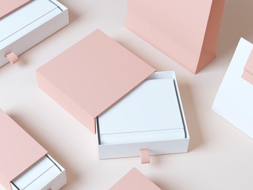 products packed in a pink and white paper boxer