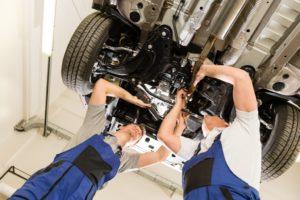 men repairing car