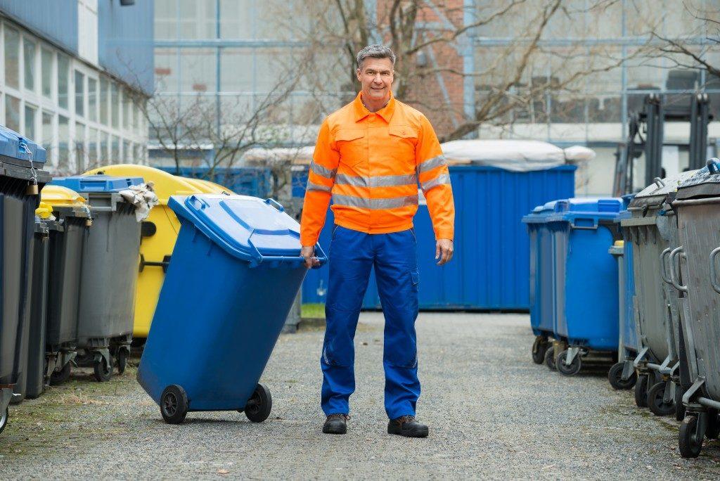 Garbage man collecting trash