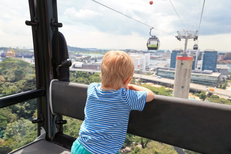 kid riding a cable car in singapore